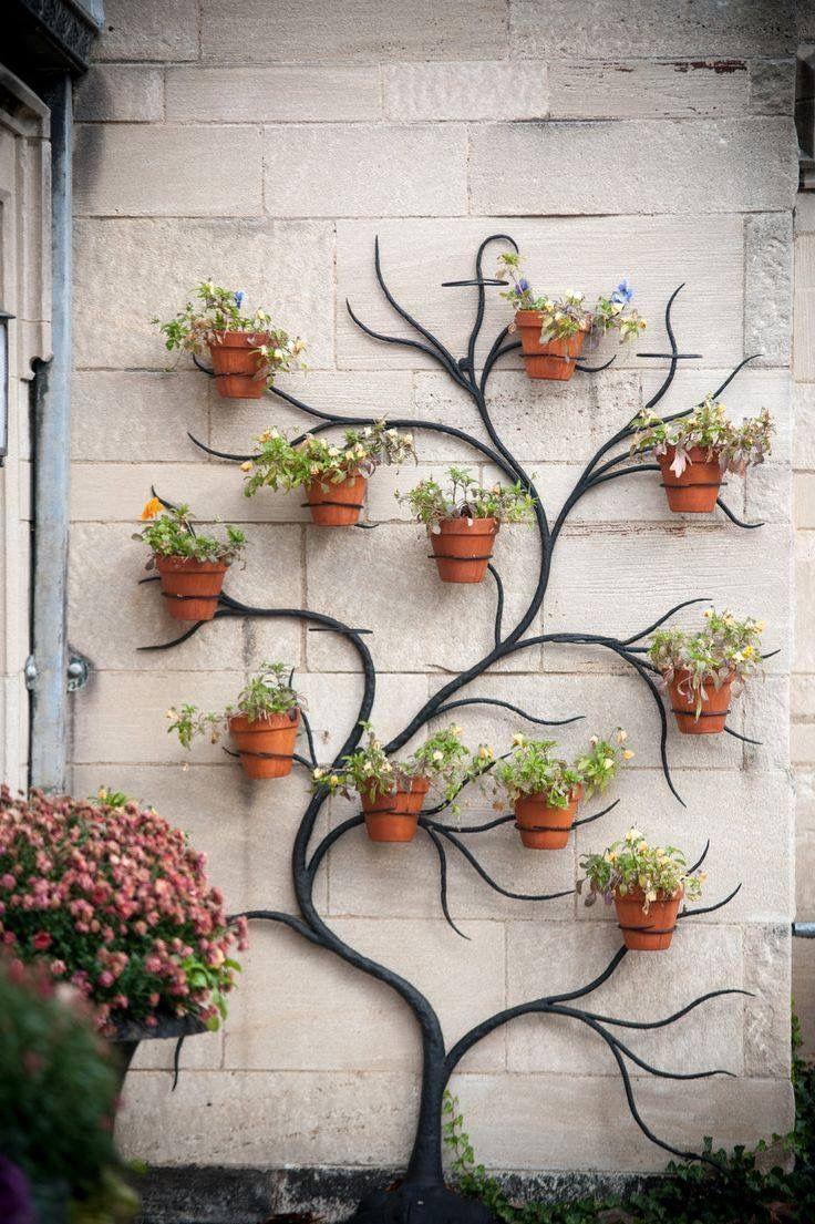 D coration murale treillage fer id e d coration deco mur exterieur jardin d co mur - Decoration murale jardin ...
