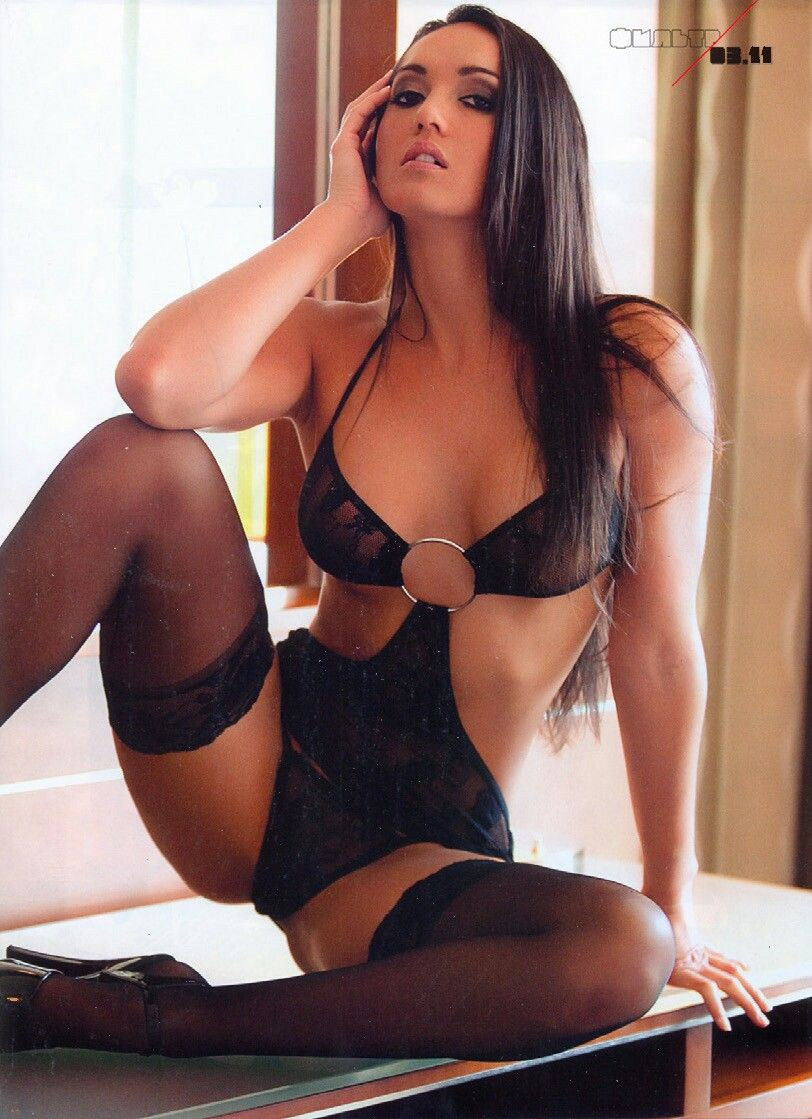 Sexy brunette babe in lingerie and stockings toys her pussy 8