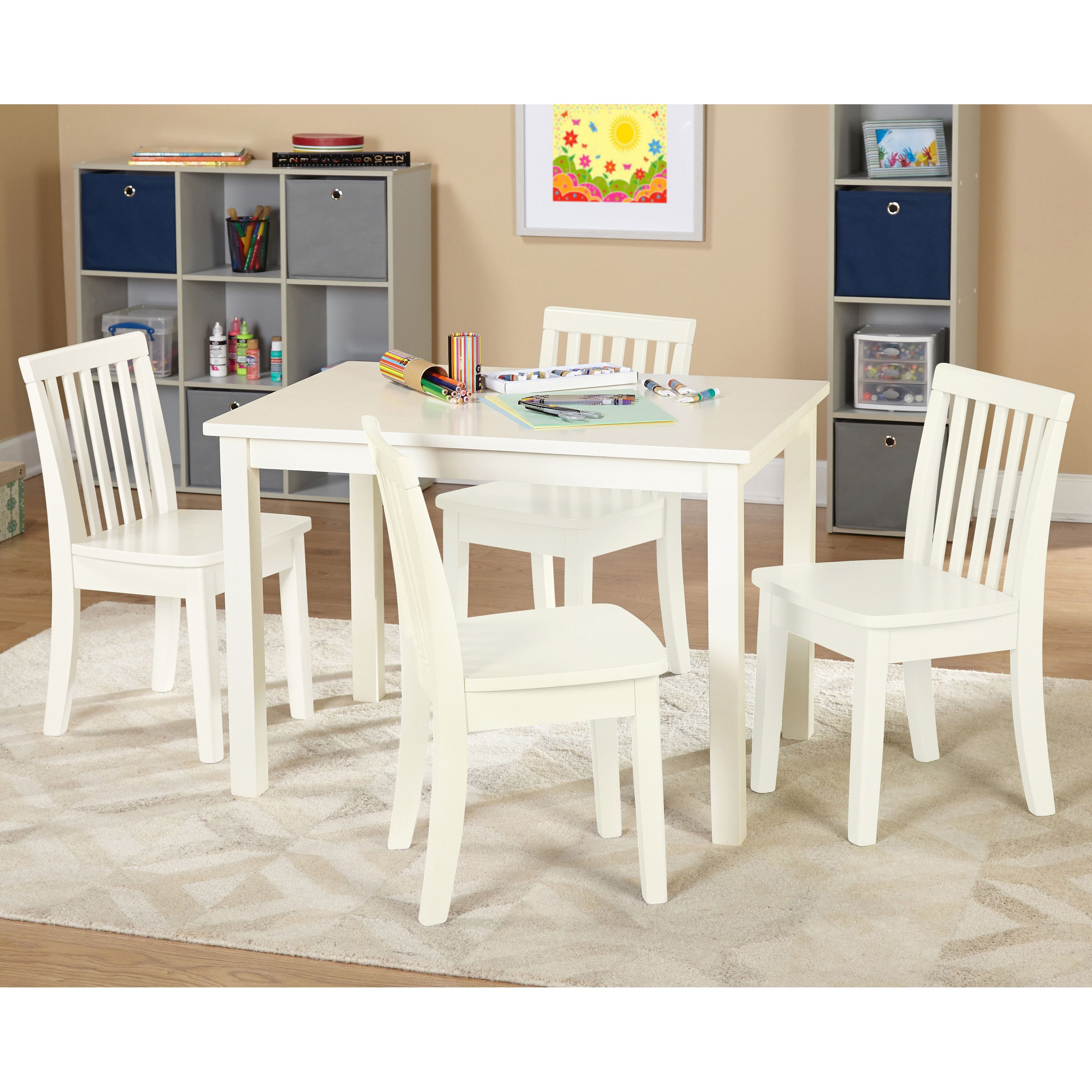 This kid-sized table and chairs set features a cream table with your ...