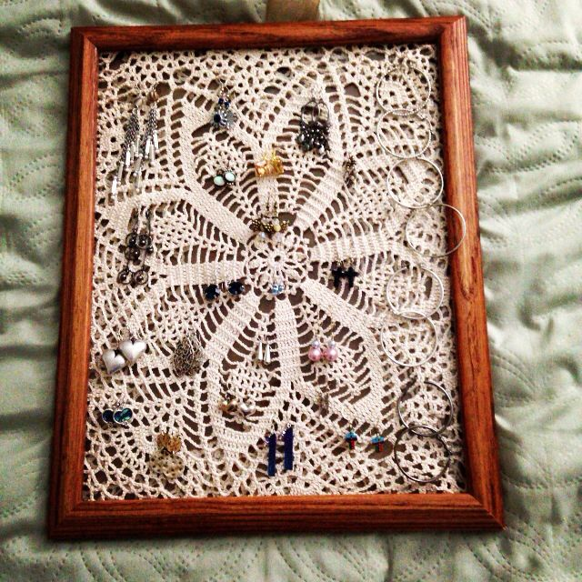 New earring holder :) A doily I had plus an old unused picture frame. Ta da!