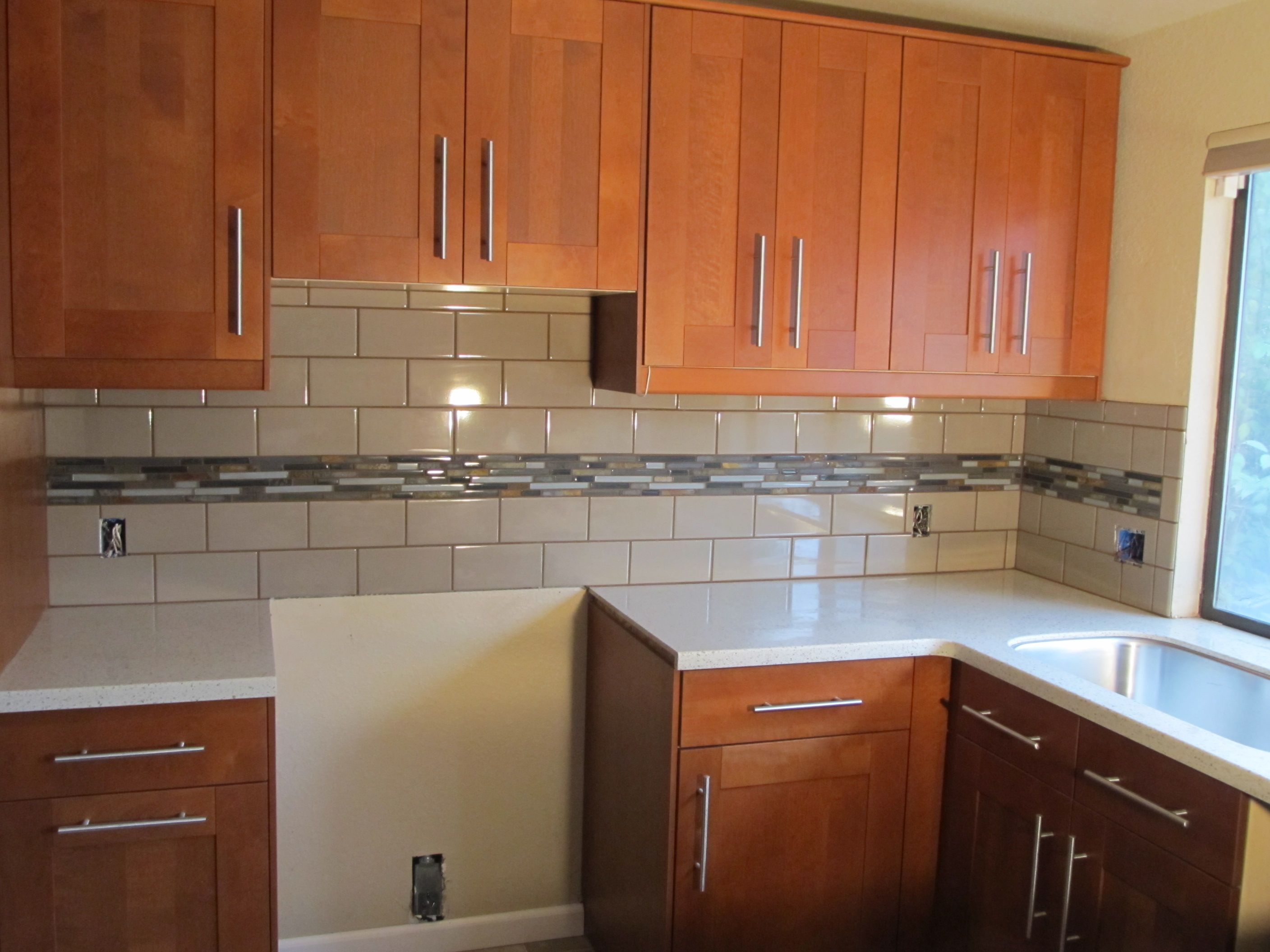 White Counters And Tile With Mosaic Tile Strip Like Baths Not A