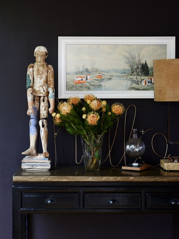 dramatic black wall in the home of Amber and Ben Clohesy shown on The Design Files