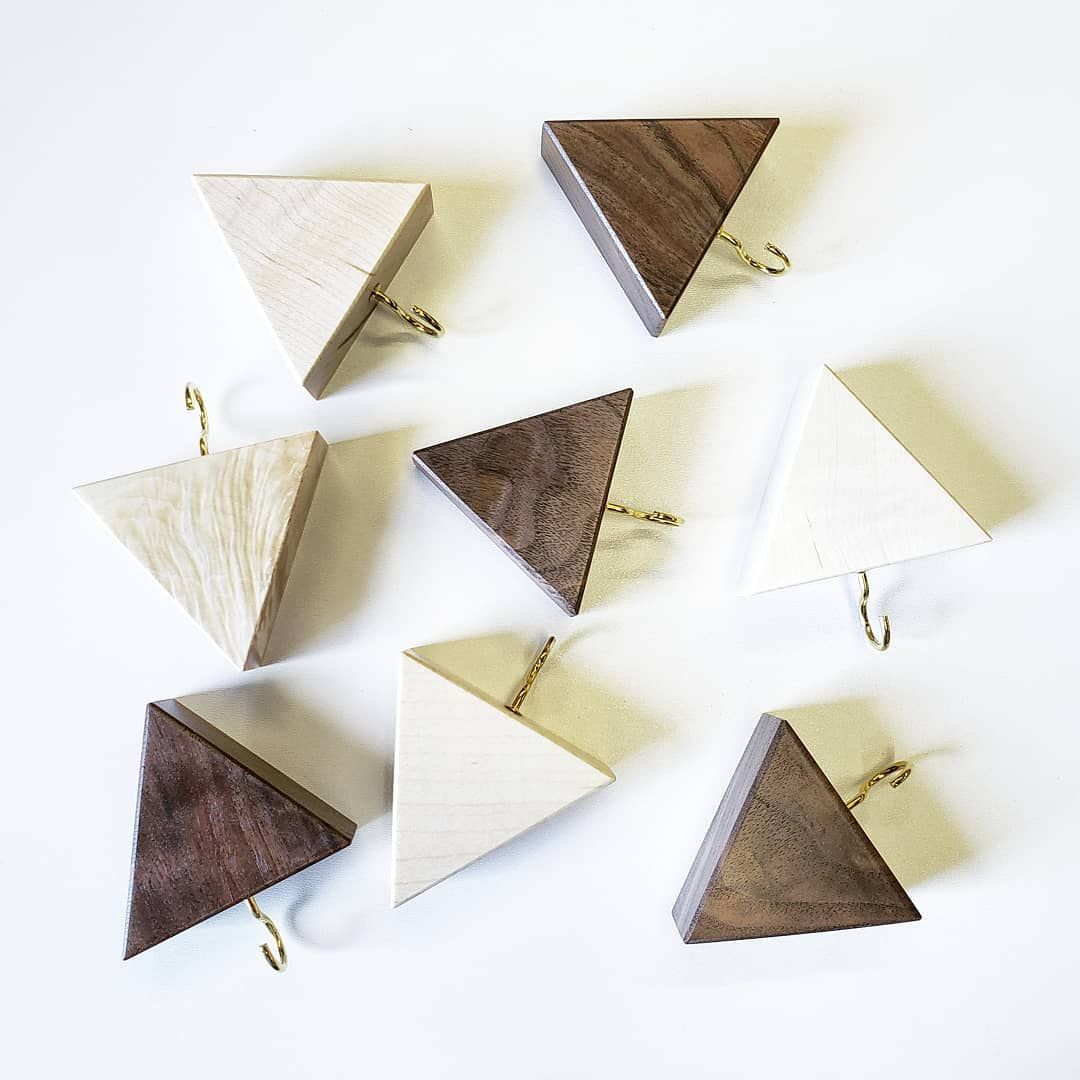 Finished another batch of triangle key holders. Walnut 🍫 and bleached maple 🍁. . . . . . . . . . . . %2