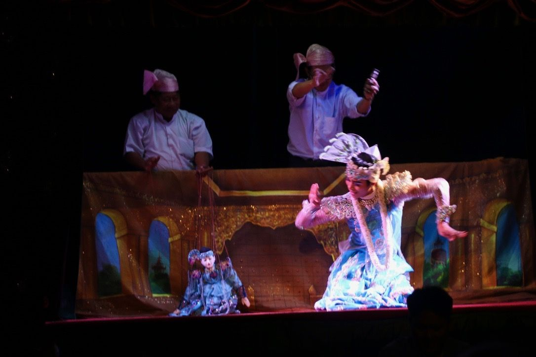 this the human and marionette dancing contest in burmese puppetry