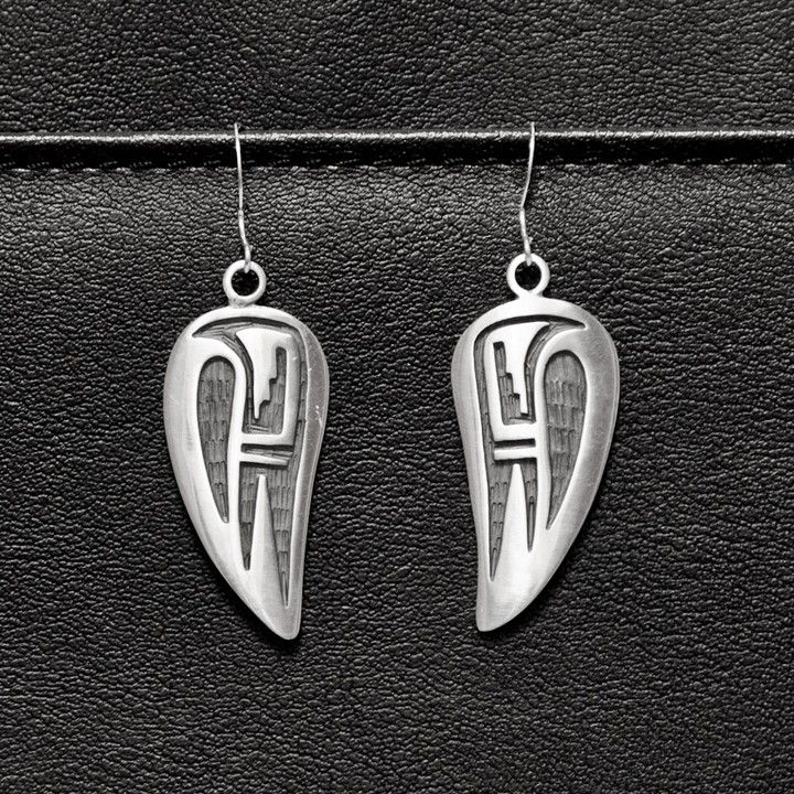 Authentic Hopi Rain Bird Earrings from Pueblo & Company | Square Market. Sterling silver, handcrafted by well-known Hopi artist Clement Honie. Stamped on the back with his turtle hallmark.
