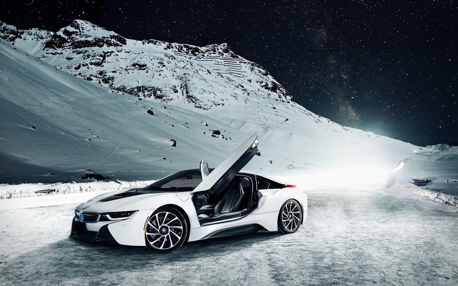 White BMW I8 In The Snow-Capped Mountains Under The Stars