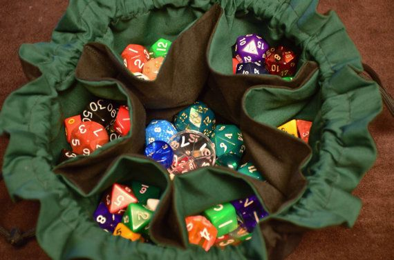 Tired of having to dump out your entire bag of dice to finally find that d4 you needed? Having 6 separate pockets to store all your various