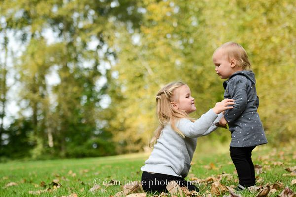 sisters playing in a field, family photography