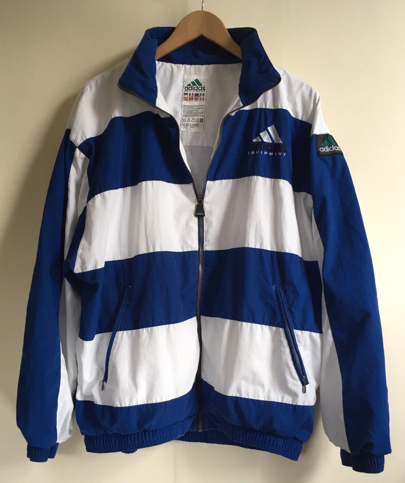 0e286fdcd7ef A Rare Vintage Adidas Equipment Jacket in a blue and white stripe Made in  Malaysia Excellent