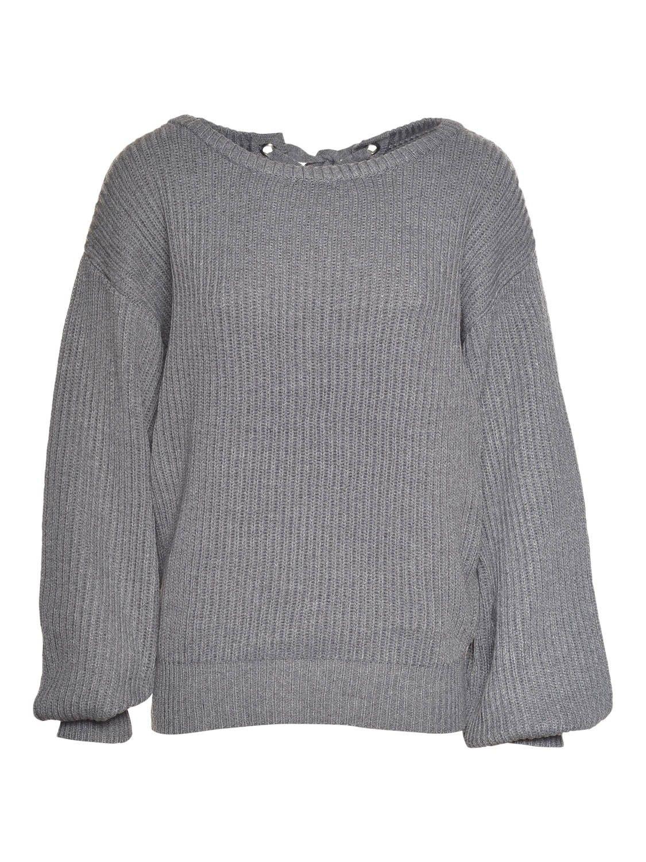 Geribde trui met ronde hals en wijde mouwen. Los model. Strik-detail aan de achterzijde. De pop draagt een Taille Unique.