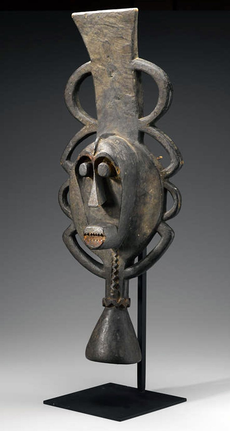 Africa | Water spirit mask from the Ijo people of Nigeria | Wood and fiber | This water spirit headdress is used in the masquerades of the Ekine men's society (also Sekiapu). The headdresses worn in such performances blend the features of humans and aquatic animals (such as the hippopotamus) or fish.