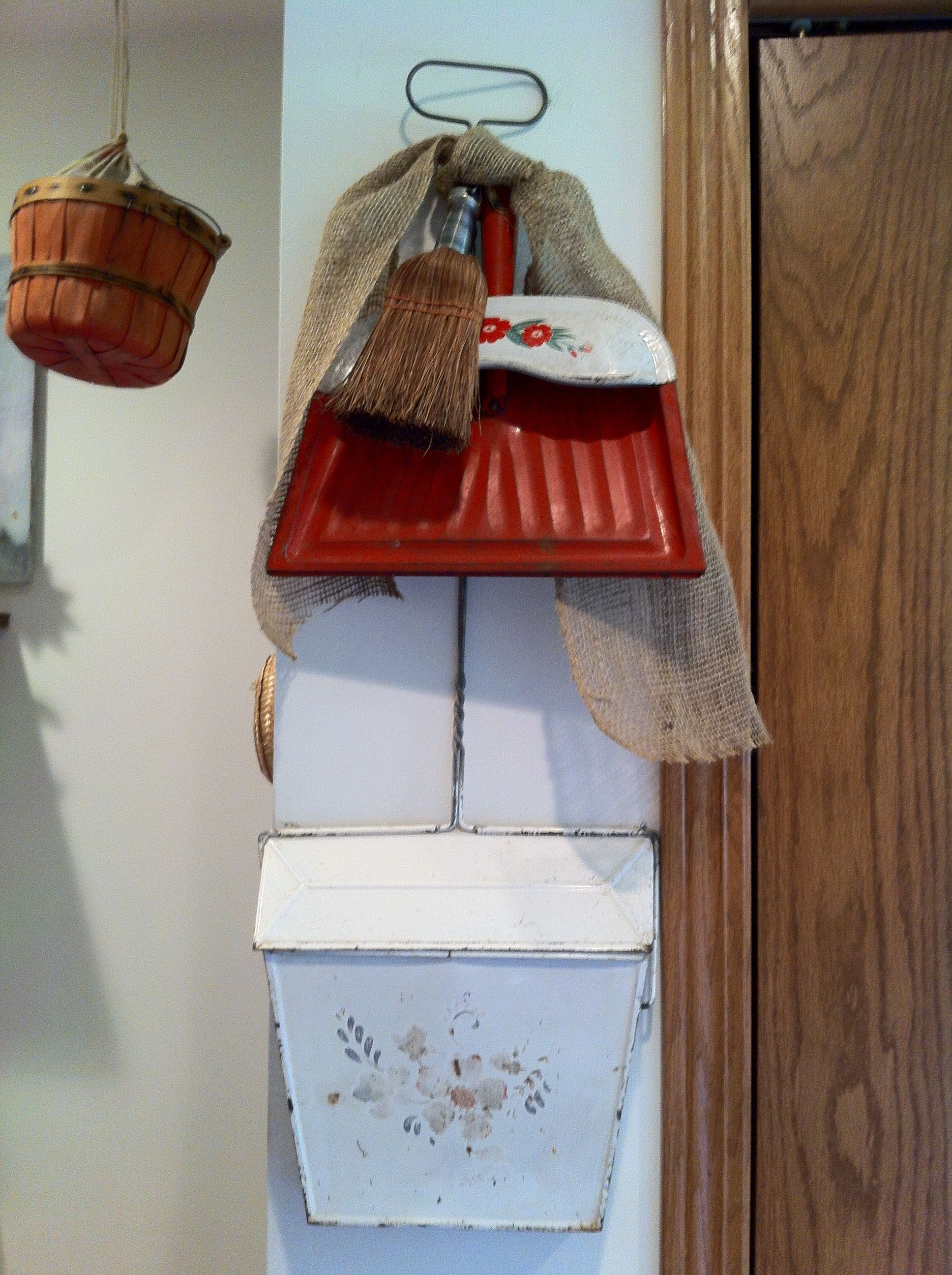 Vintage dustpans an old whisk broom and burlap ribbon.
