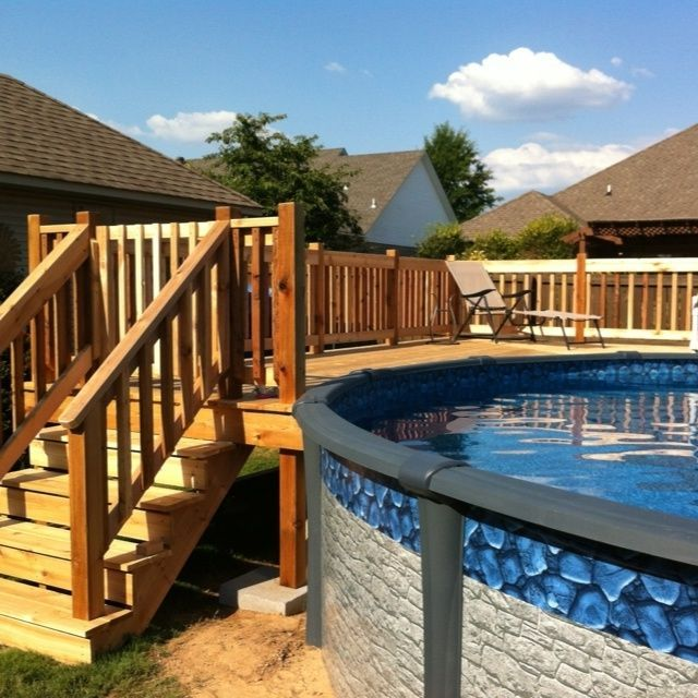 above the ground pool with stairs made of wood