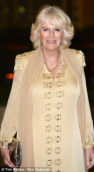 Camilla covers up: Demure Duchess of Cornwall wears headscarf for
