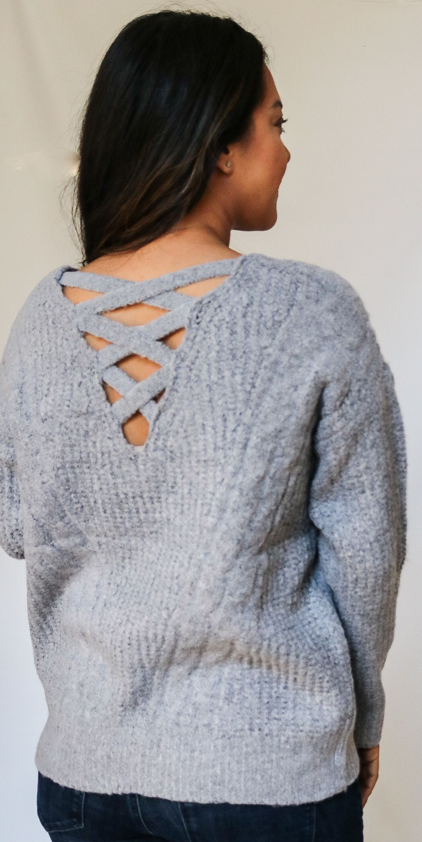 610db709f3b6ae THE EVELYN SWEATER: Grey brushed knit pullover sweater features cable  stitch and criss cross back detail.