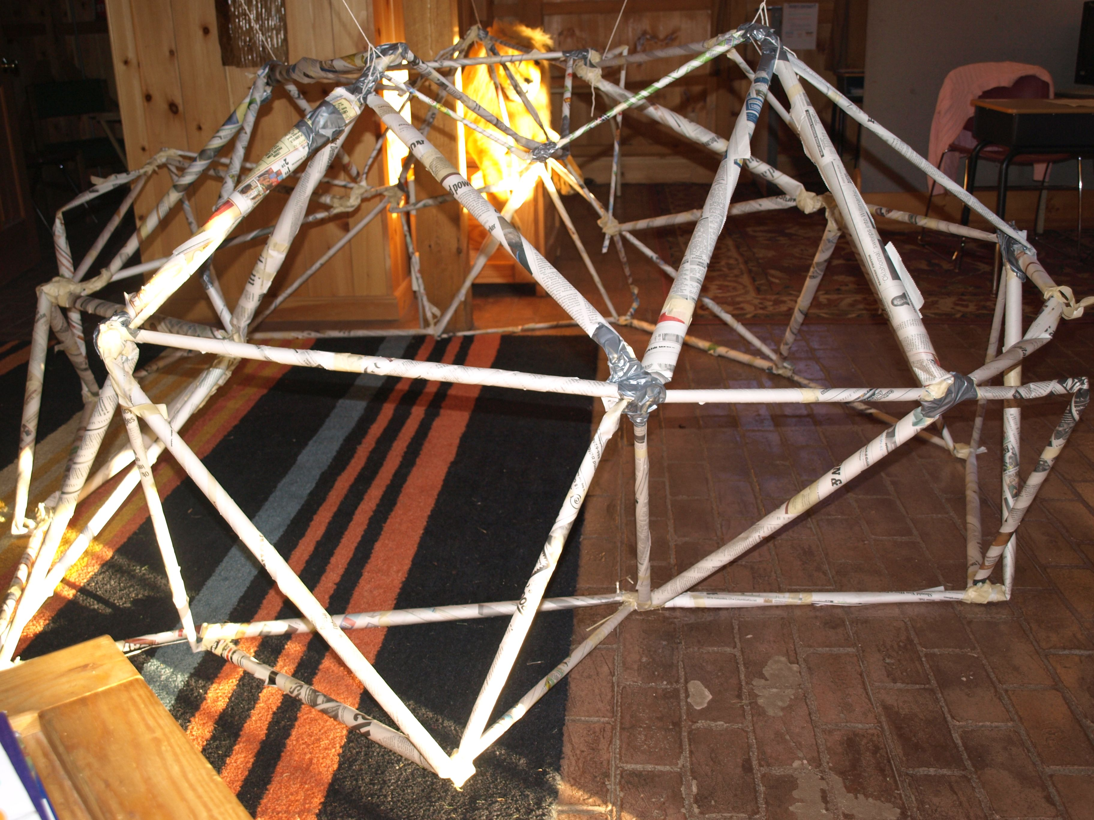 Geodesic Dome Made Of Rolled Newspapers And Tape With