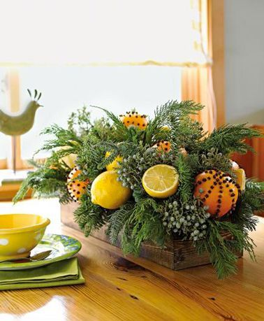 Christmas centerpiece made with fir branches, orange, lemon and gilt nails Christmas centerpiece made with fir branches, orange, lemon and gilt nails
