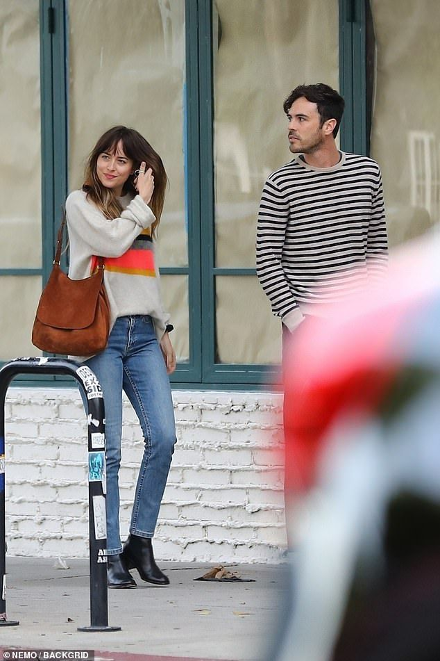 Dakota Johnson is all smiles after dinner date with a friend