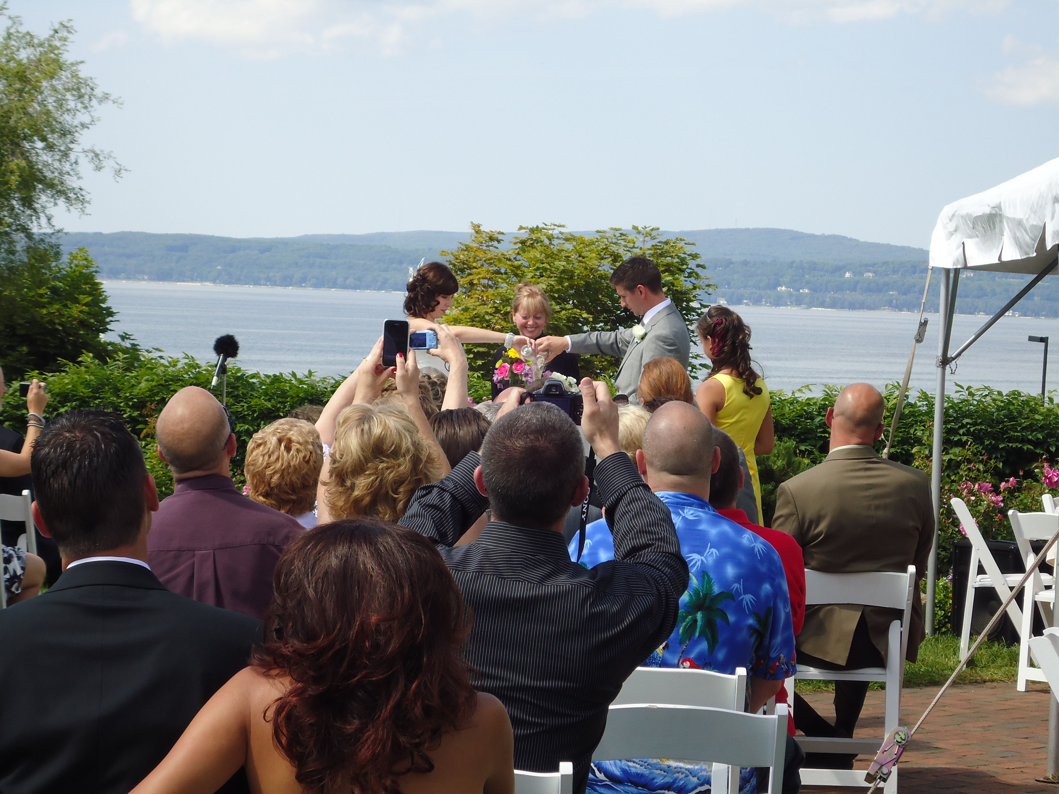 Small wedding ceremony overlooking little traverse bay at the perry