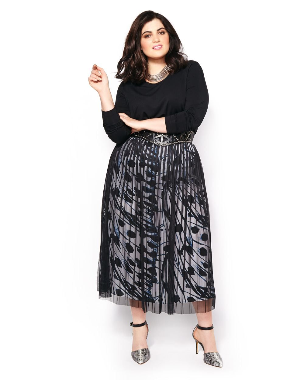4ba3150359fbc This plus-size long sleeve top from Melissa McCarthy is a versatile piece  to dress