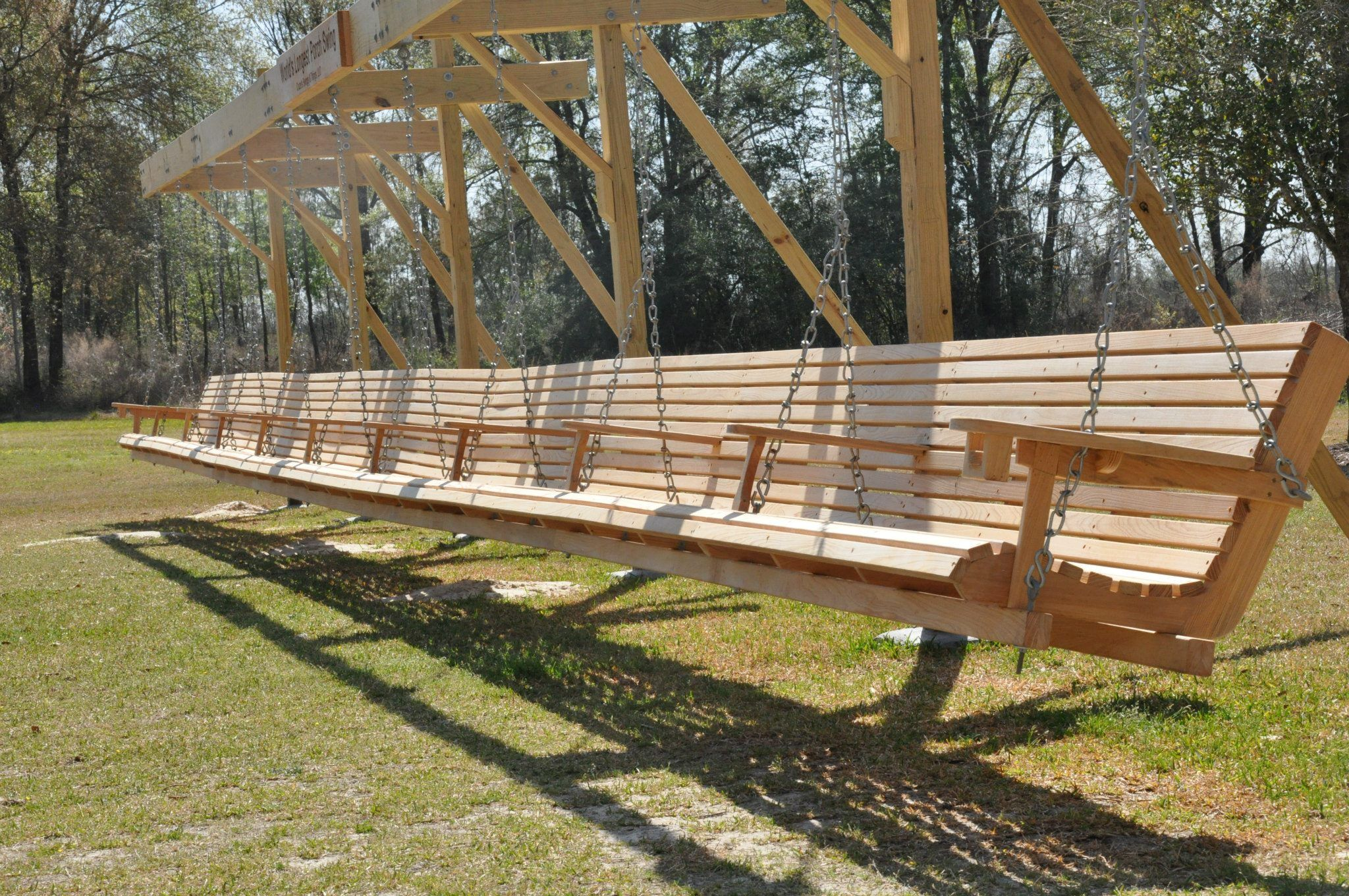 Check Out The Guinness World Record For Longest Porch Swing It Was Built By Christopher Cruze In Louisiana And Hanging Porch Swing Garden Swing Porch Swing