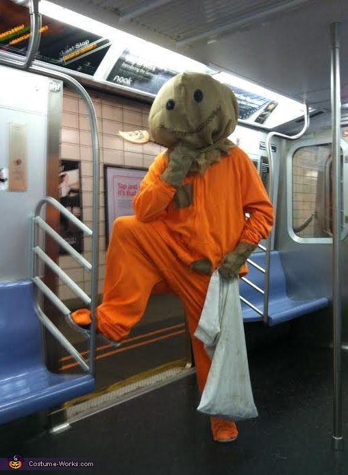Tiffany: This was my husbands costume. Sam from the horror movie Trick r Treat. We made a simple orange onesie and attached a few burlap patches to it. For the head,...