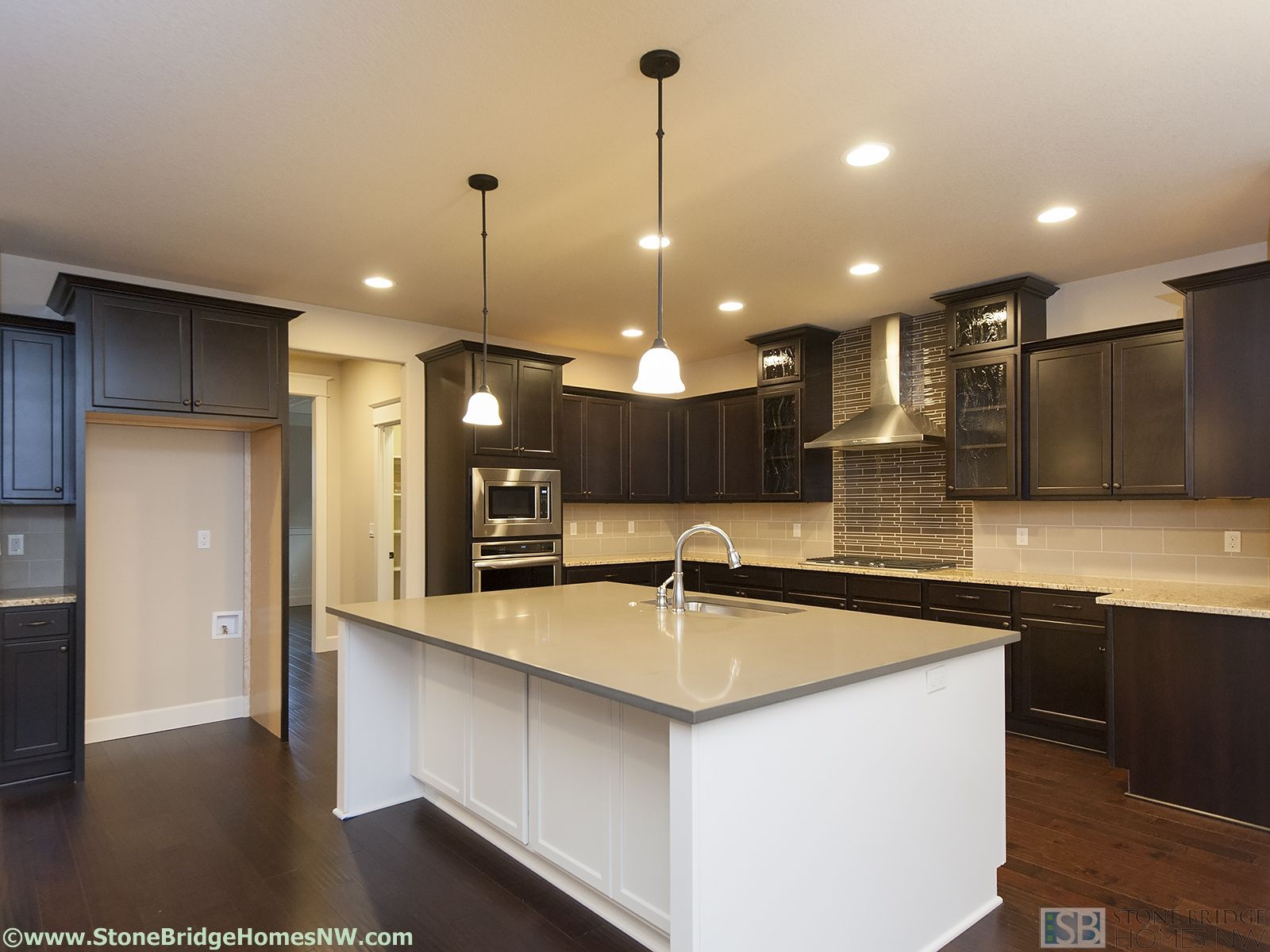 Brown cabinets with kitchen island and tile back splash. | Kitchen ...