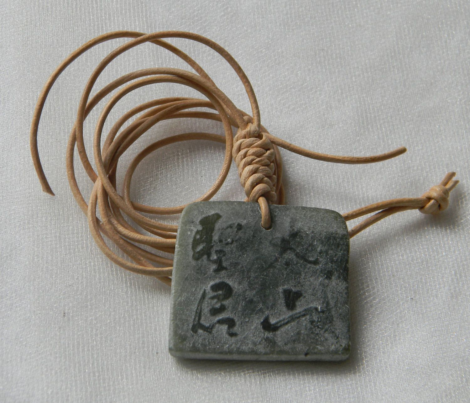 cable a carved jade product pendant with jadeite chain green
