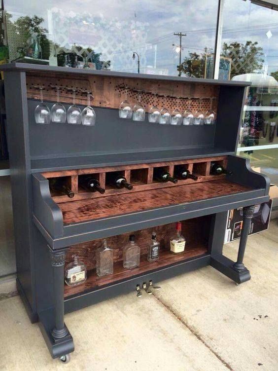 #UpCycle #PianoBar This upcycled piano bar has been created from a 1908 Heintzman piano. In place of the keys, there is a serving area with wine storage, and wine glass display above, which uses the tuning pins. This stunner would make an amazing conversation piece. Would this have pride of place in your home?