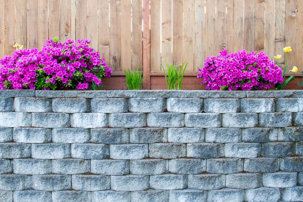 Which One To Choose A Timber Or Concrete Retaining Wall Adc Hardscapes Retaining Wall Contractor In Oklahoma City Edmond Ok Hardscape Concrete Retaining Walls Retaining Wall