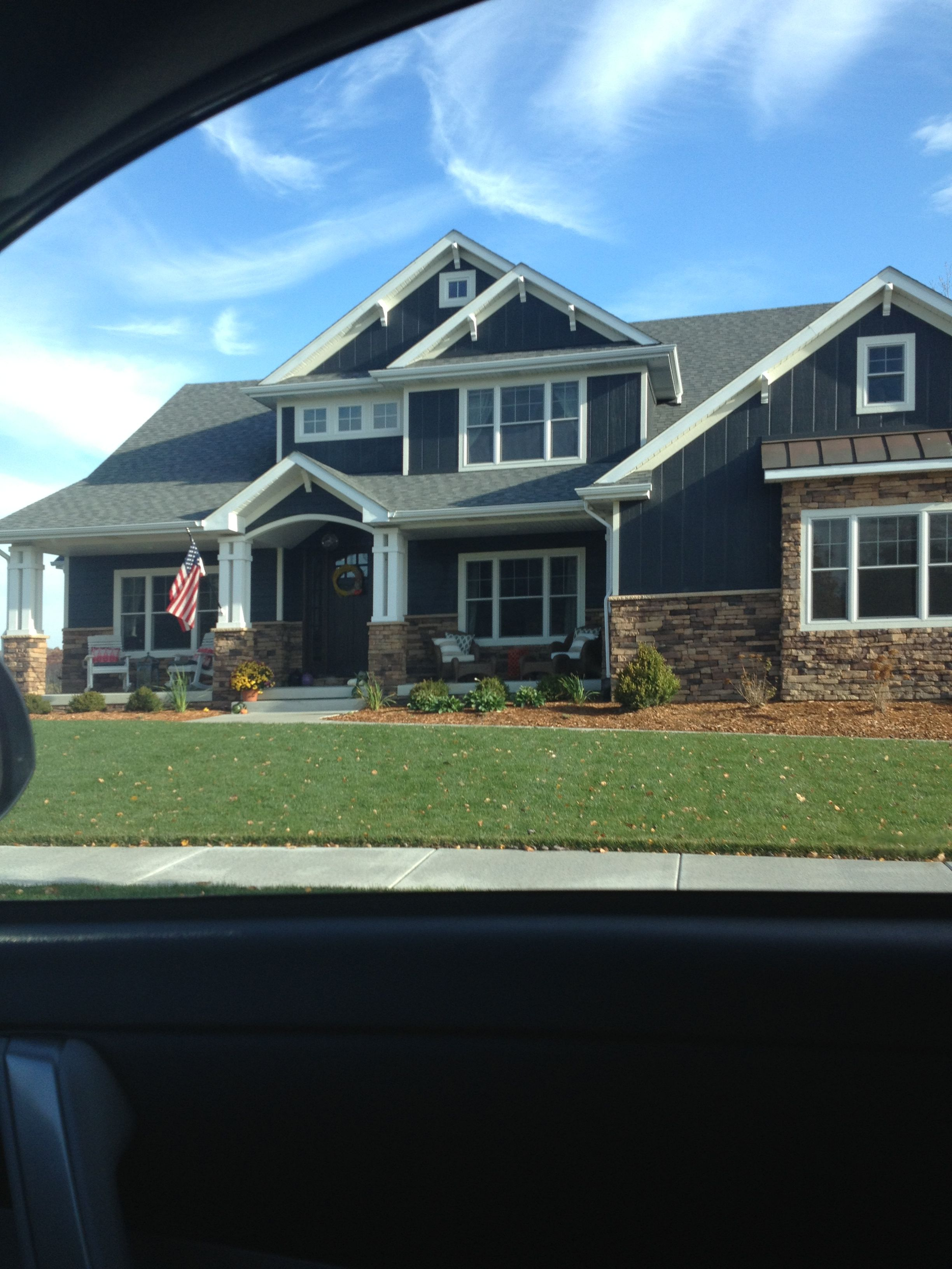 Love the dark blue siding, dark brown brick and white pillars/trim ...