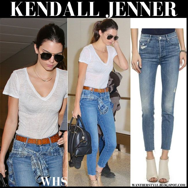 Kendall Jenner in ankle fray skinny jeans and snake skin ankle boots at LAX  on August 6