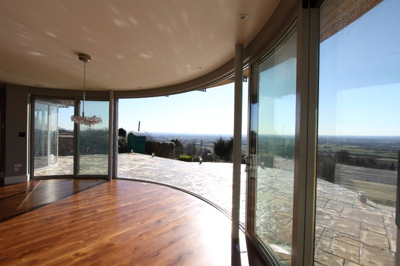 Curved glass sliding doors for Curved glass wall