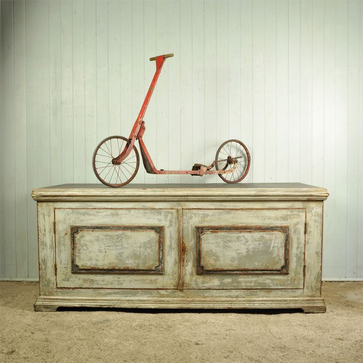 antique scooter on great old chest