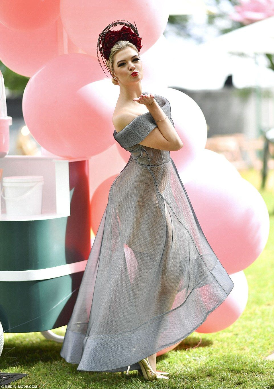 afc02e8c0c5 Simple and stylish  One woman stunned in a modern sheer grey gown paired  with a beautiful floral headband (Melbourne cup 2016)