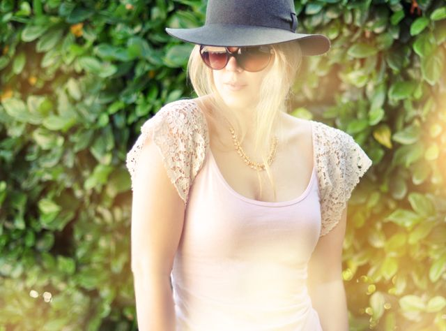 This is a plain spaghetti strap tank top with lace sewn onto it. Such a fabulous idea, I have a million of these tanks.