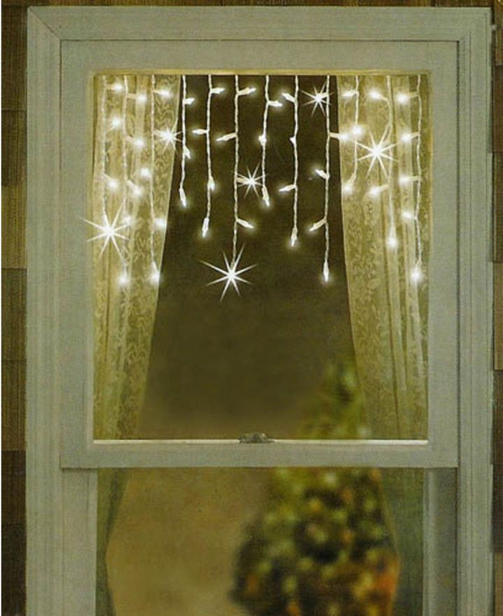twinkling shimmering white window curtain icicle christmas lights