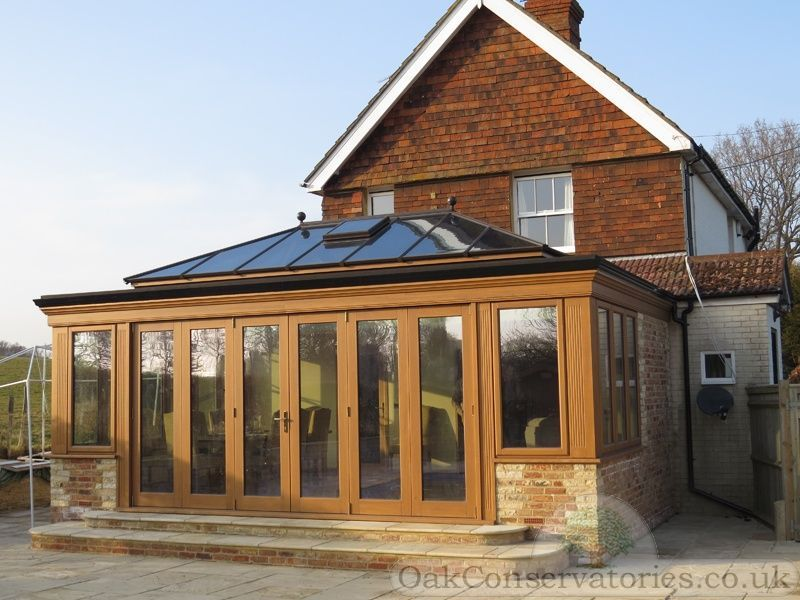 Contemporary seasoned oak orangery design with traditional for Orangery ideas uk