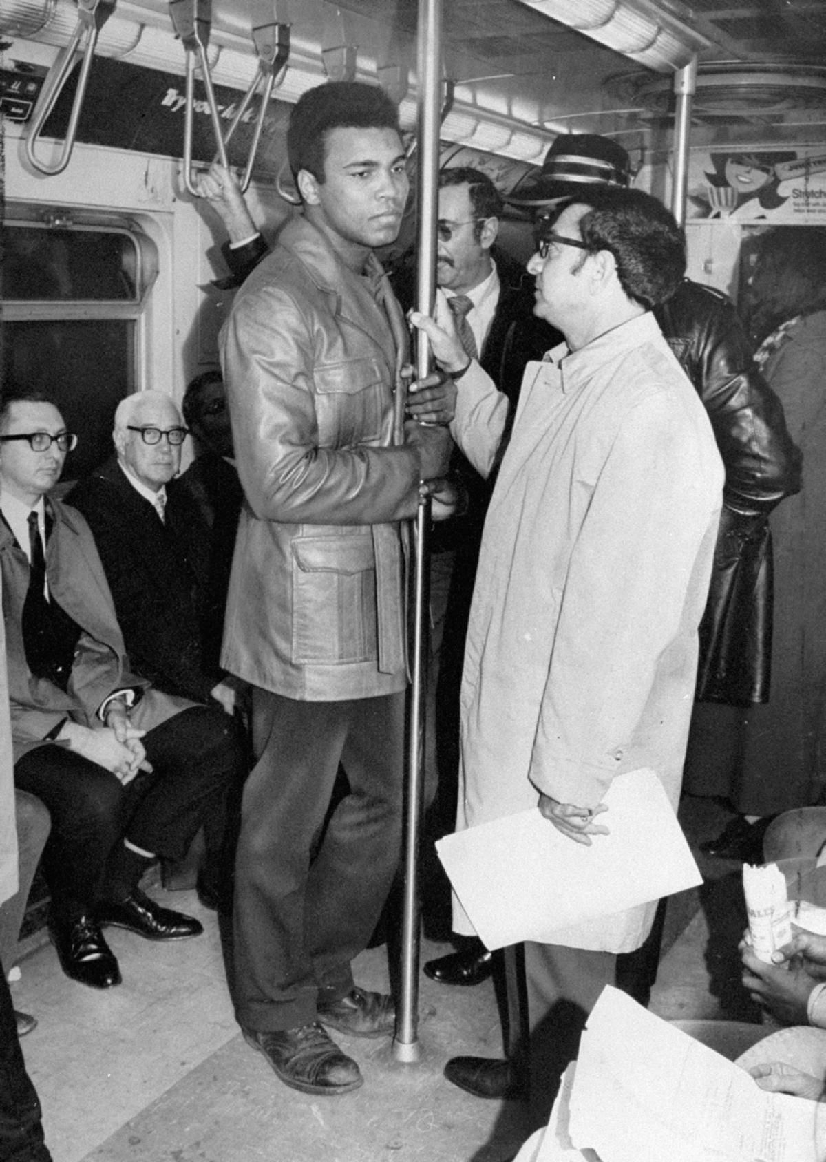 Muhammad Ali Cassius Clay Stands In Subway Car With