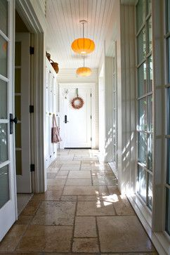 Stone and glass entry allows entrance to various parts of the house (e.g. mudroom, kitchen...)