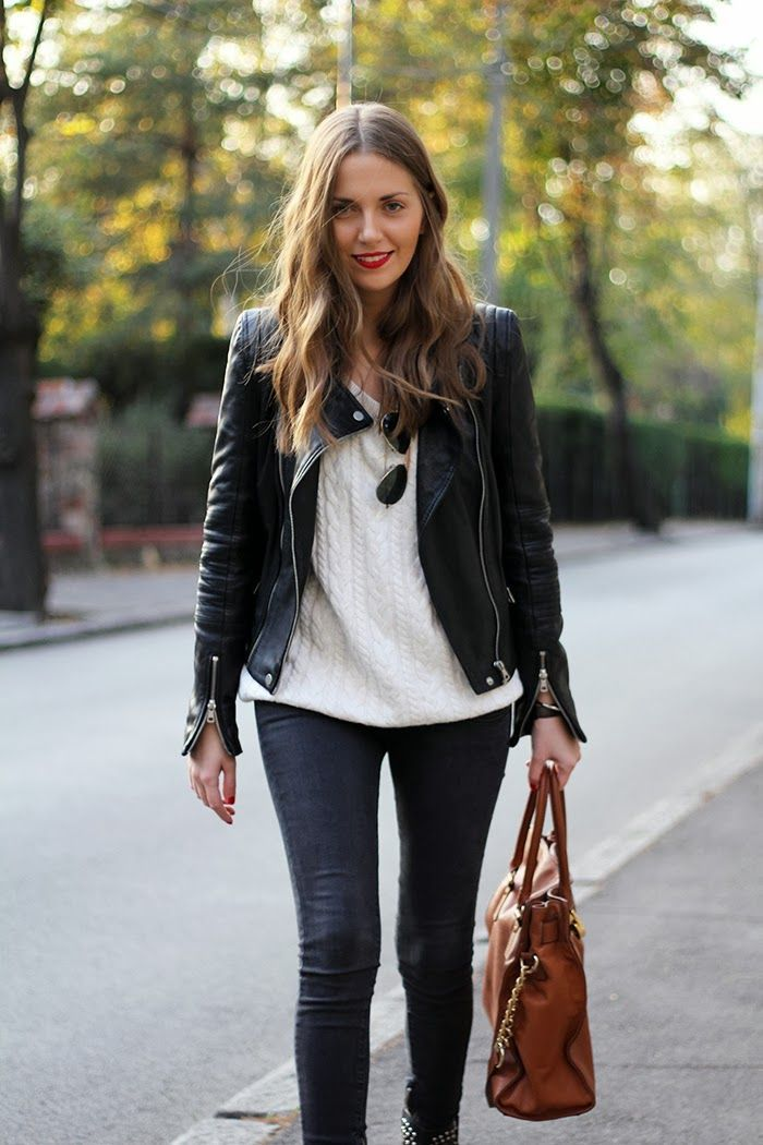 White sweater, brown tote bag and leather coat.