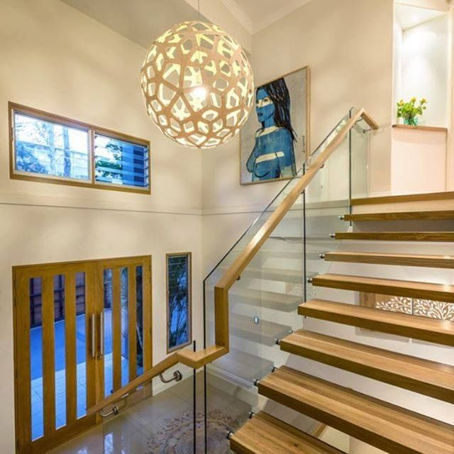 The David Trubridge CORAL in Natural, fitting right in with the wood accents of this foyer in this Queensland, Australia home.  The CORAL pendant light is made of bamboo plywood, from David Trubridge Design. Click image for where to buy!