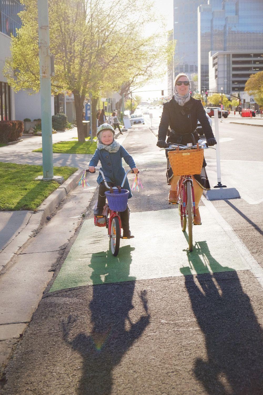 Protected bike lane on Broadway helps create a family friendly biking network in Salt Lake City.