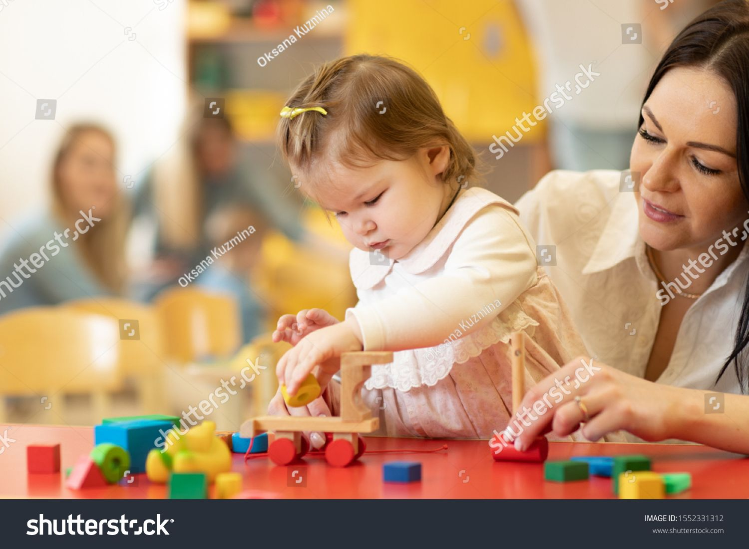 Child Building Blocks With A Teacher In The Nursery Ad Affiliate Building Child Blocks Nursery Building Blocks Nursery Children