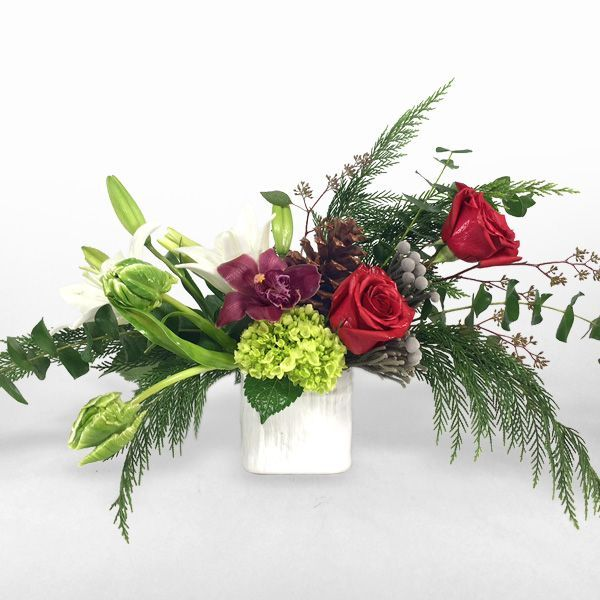 HOLIDAY SWAG - Red roses, green hydrangea, eucalyptus, brunia, lilies, cymbidium orchid blooms, and assorted greenery.
