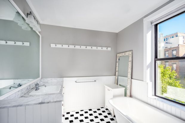 The master bathroom is spa-like with a chic claw-foot soaking tub and separate shower.