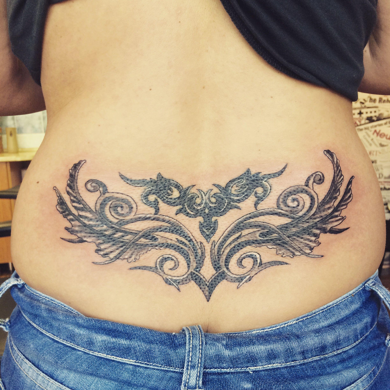 фото цветных татуировок на пояснице поделиться