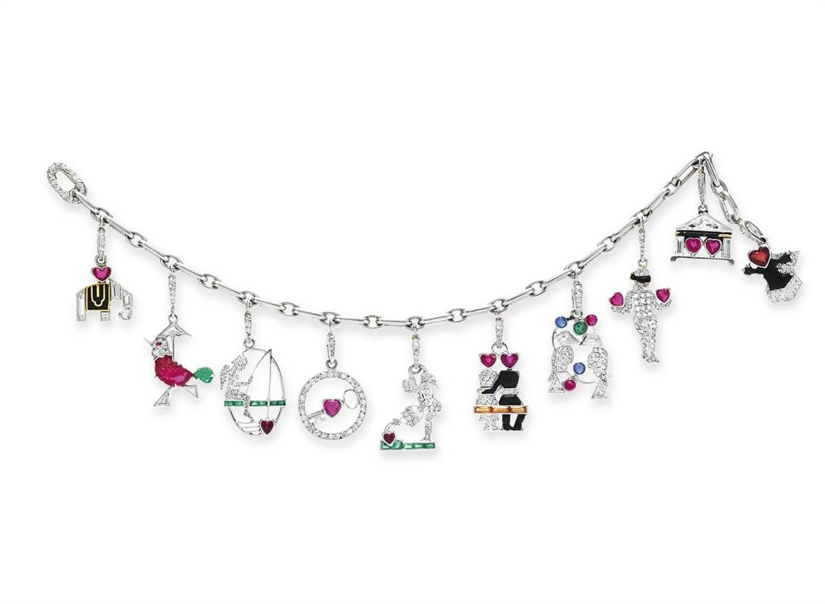 An Art Deco Diamond And Multigem Charm Bracelet With Charms, By Cartier,