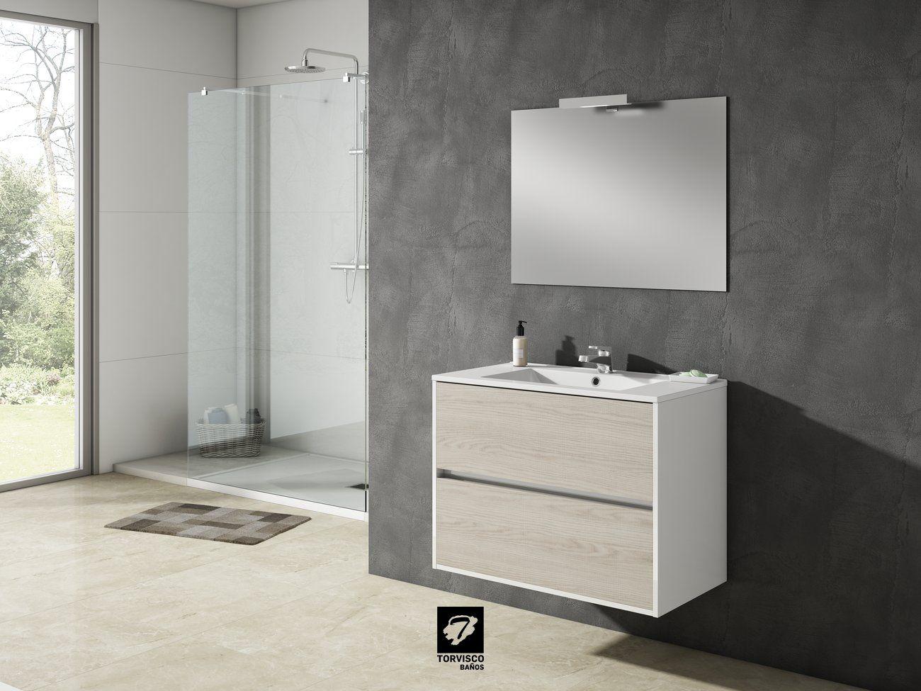 Mueble de baño modelo TAIGA. 80cm de ancho y 45cm de fondo. Dos cajones, suspendido. Espejo Odín, encimera Extrafina y foco X.