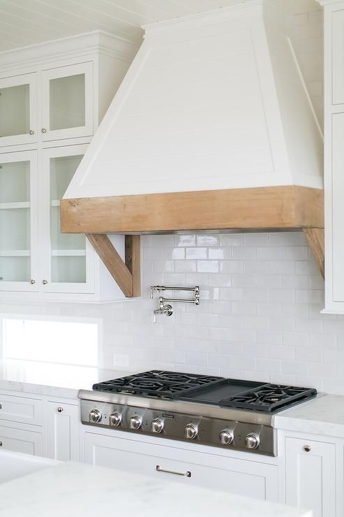 Gorgeous Kitchen Features A White French Hood With A Rustic Wood Trim And Brackets Fixed Between Glas Kitchen Range Hood Modern Farmhouse Kitchens Kitchen Vent